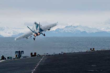 "PACIFIC OCEAN (May 13, 2019) An F/A-18F Super Hornet assigned to the ""Black Knights"" of Strike Fighter Squadron (VFA) 154 launches from the flight deck of the aircraft carrier USS Theodore Roosevelt (CVN 71) while participating in Exercise Northern Edge 2019. Northern Edge is one in a series of U.S. Indo-Pacific Command exercises in 2019 that prepares joint forces to respond to crisis in the Indo-Pacific region. (U.S. Navy photo by MC3 Andrew Langholf"