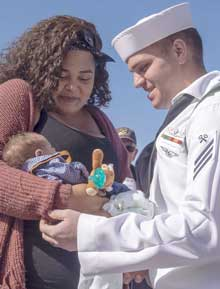 "SAN DIEGO (May 28, 2019) Logistics Specialist Seaman Jonathon Mendez meets his newborn baby after returning from deployment aboard the guided-missile cruiser USS Mobile Bay (CG 53). Mobile Bay, including detachments from Helicopter Maritime Strike Squadron 71 ""Raptors"", returned to their home port of San Diego following an around the world deployment to all six geographic Fleet areas of operation as part of the John C. Stennis Carrier Strike Group, May 28. U.S. Navy photo by MC3 Chanel Turner."